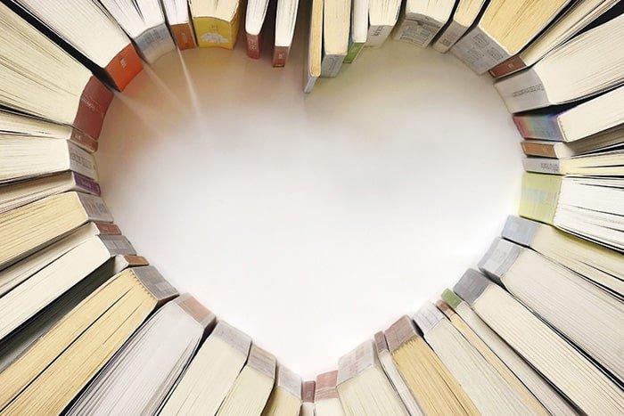 books-arranged-on-table-in-shape-of-heart-min.jpg